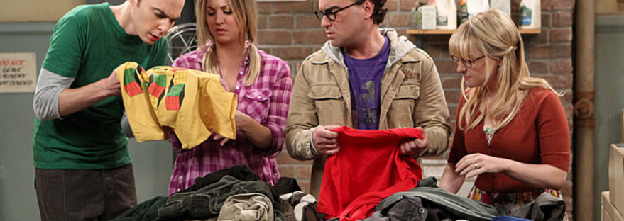 Sheldon, Penny, Leonard and Bernadette stand in the laundry room going through a pile of clothing.