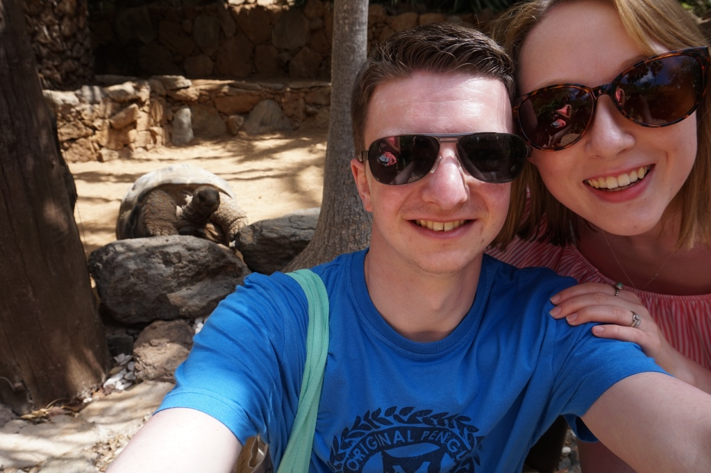 Me and Liam taking a selfie in front of a tortoise at Palmitos Park in Gran Canaria