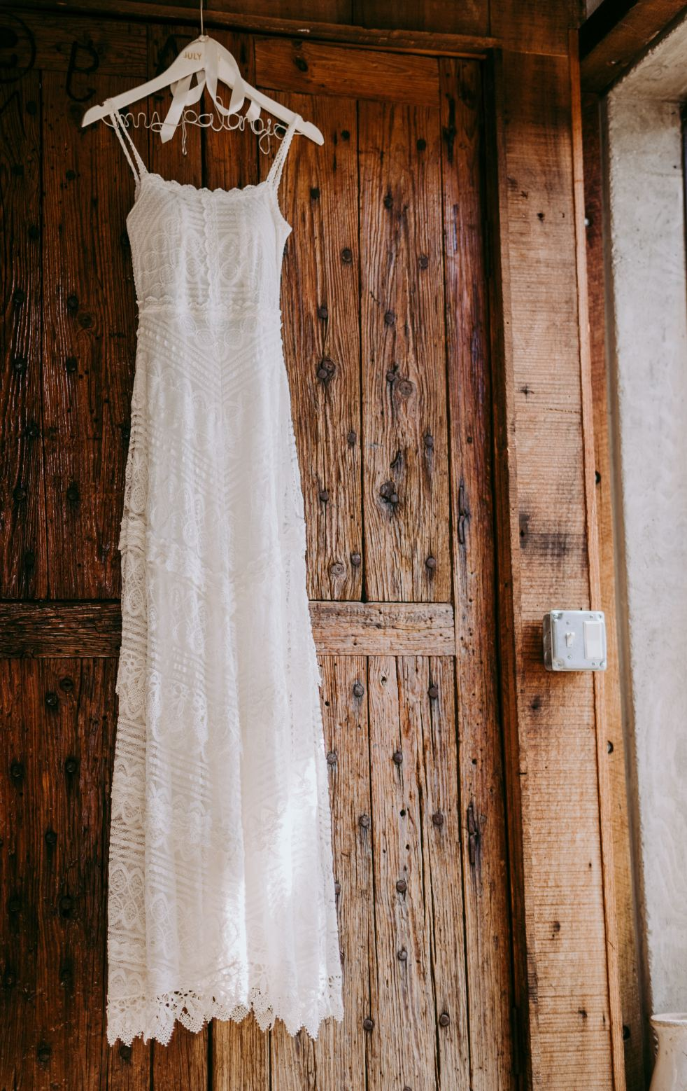 Wedding Dress Hanging Up - Featured Image