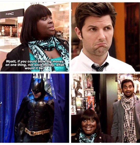 """Parks & Recreation - Treat Yo Self scene.  Donna tells Ben """"Wyatt, if you could blow big money on one thing, not sock money, what would it be?"""" Ben looks thoughtful. We next see him coming out of a fitting room in a full Batman costume. Donna and Tom both have amazed smiles on their faces."""