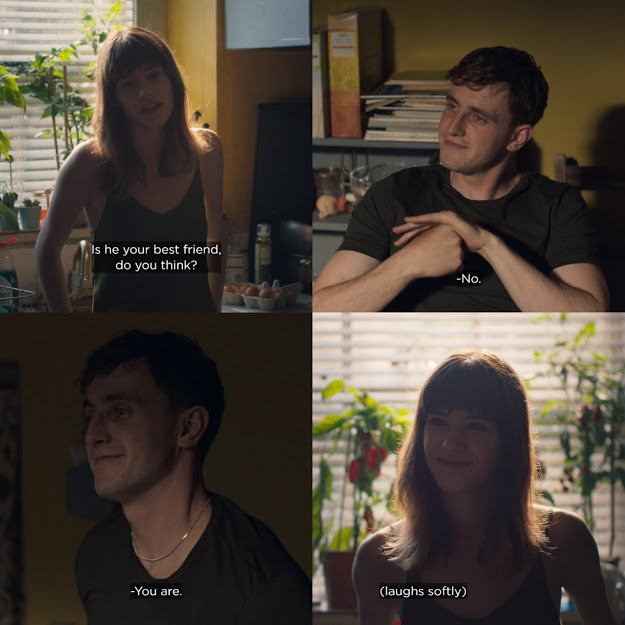 """Still from Normal People. Marianne asks Connell """"Is he your best friend, do you think?"""" Connell smiles at her and gets up to approach her, telling her """"No. You are."""" Marianne smiles and laughs softly."""