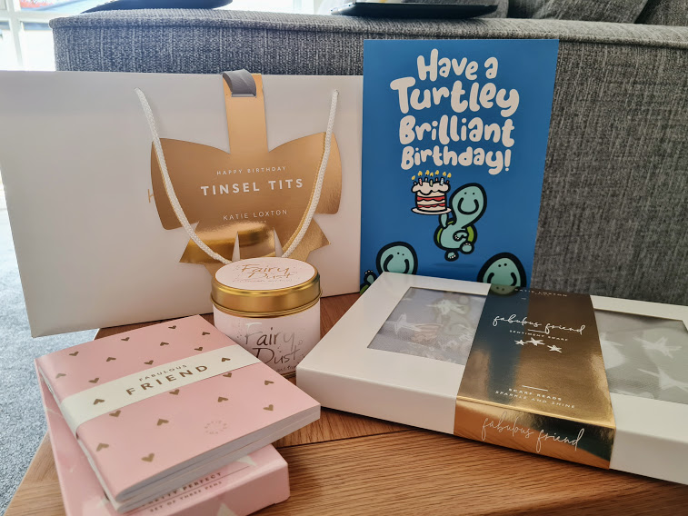 """My birthday presents from Lillie - a gift bag, scented candle, notebook and pens with """"Fabulous Friend"""" on and a star patterned scarf. There's also a birthday card that says """"Have a turtley brilliant birthday!"""""""