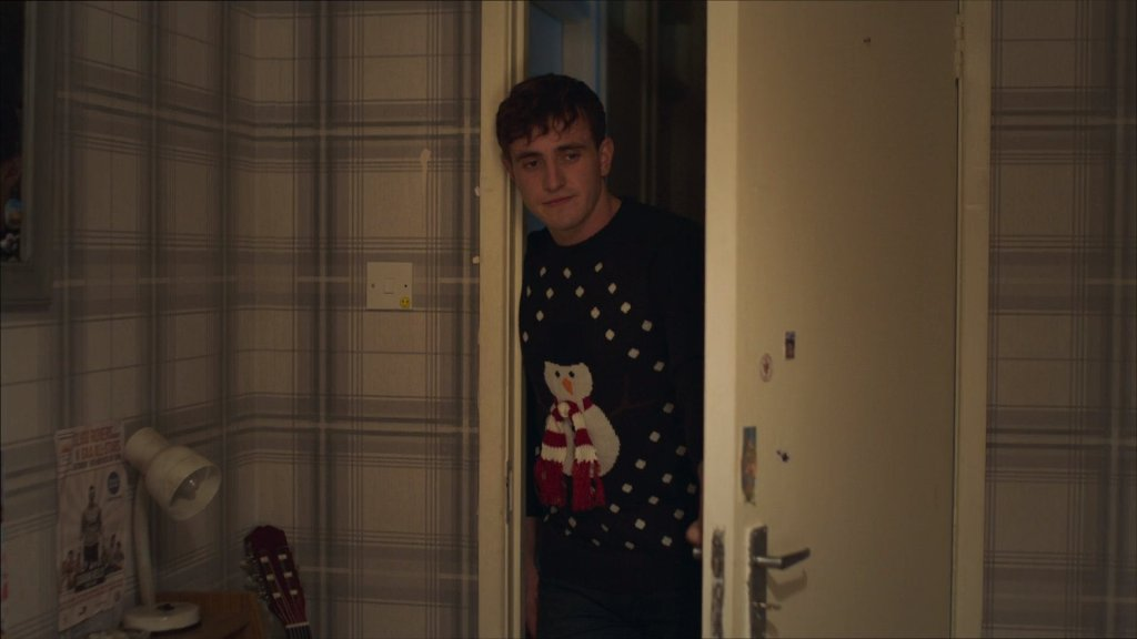 Screen grab of Connell wearing his snowman Christmas jumper.