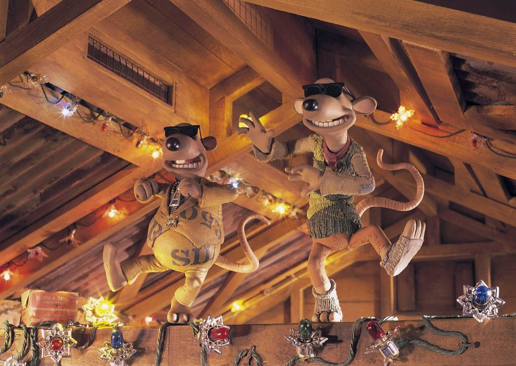Nick and Fetcher dancing on one of the beams in the hut. They have decorated it with Christmas lights and are both wearing sunglasses in a similar style to the Blues Brothers.