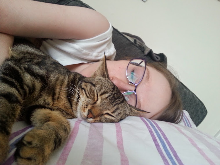 Tilly and me cuddled up together. We're both asleep.