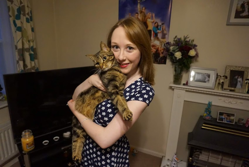 Me holding Tilly - we're both looking straight at the camera.