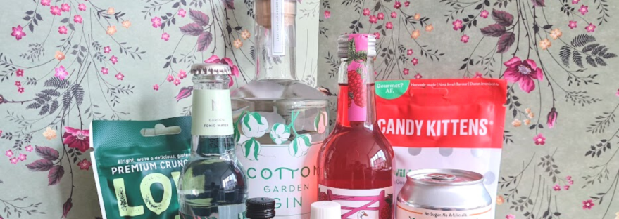 September's gin offerings against a floral backdrop
